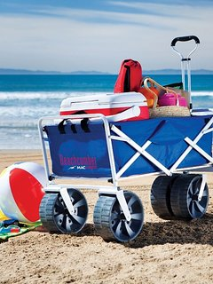 A foldable beach trolley in our townhouse for use during your stay