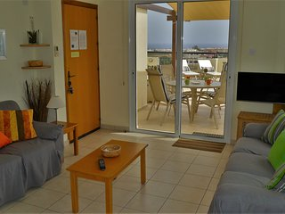 Lounge area with sea views, A/C, sofabed and internet TV with many English programmes