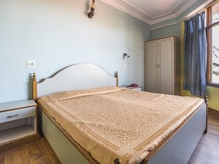 Centrally located room for 3 with a hilly view