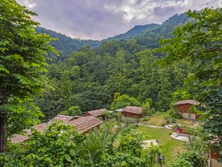 Rustic hut for a large group amidst rich greenery