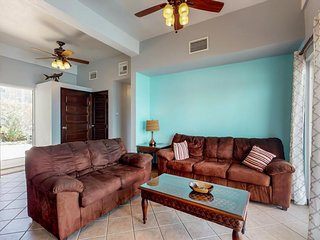 NEW LISTING! Lagoon-front, ground-level condo with shared pool-near the beach