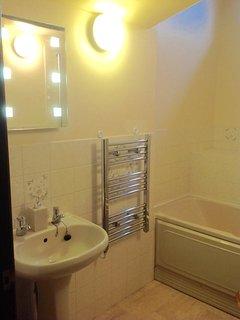 Family bathroom with bath, shower, heated towel rail and toilet