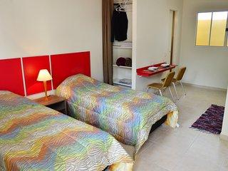 Unidade com 2 camas de solteiros - STUDIO ANA LAURA