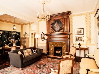 The salon features a Louis XIV fireplace with an 17th century Dutch still life.