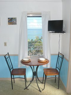 Inside and outside dining with Cable TV.
