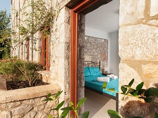 Amazing Stone Maisonette next to the sandy beach