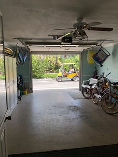 Garage with beach items to use.  Chairs, toys, umbrella, bikes.