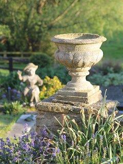 Urns and statue in garden