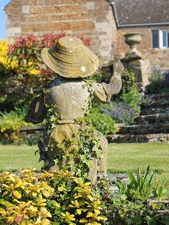 Statue and urn in garden