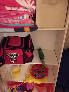 Beach Towels, toys, and cooler bag are in the guest room closet.