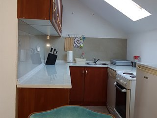 Fully equipped kitchen with stove, owen, kettle and fridge