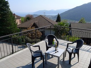 Vertigo on the panoramic hill over Verbania with garden and lakeview