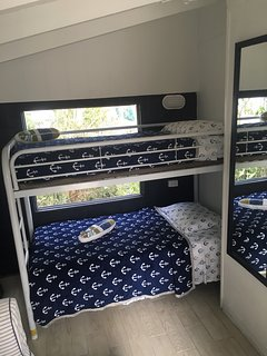 good size 2nd bedroom with twin bunks, love seat & AC.