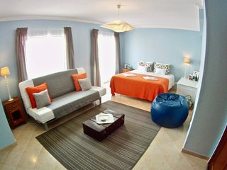 spacious suite with private bathroom in front supertubos beach