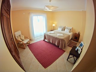 sunny double bedroom with balcony in front of supertubos beach