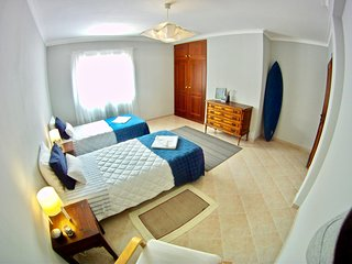 bright triple bedroom in front of supertubos beach