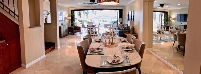 Our indoor dining area features a gorgeous marble table and tailored chairs with all the trimmings.