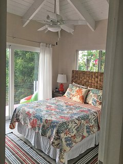 Your main floor guest bedroom has been redecorated and opens on to the pool deck (2018 photo)
