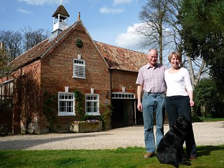 Paul, Flora and Jessie in front of Brackenborough Hall Coach House, showing Saddle Room to the left