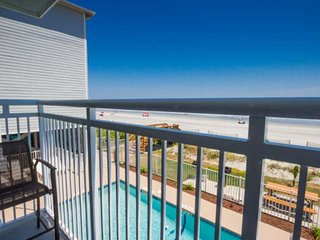 Spend your vacation watching the ocean and pool from this wonderful covered balcony.