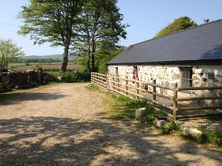 Converted stone barn centrally located for a great North Wales experience.