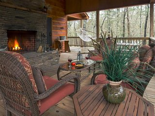 Cozy cabin near the river features private hot tub, free WiFi, & great location!
