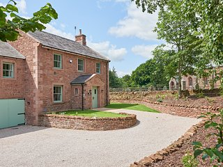At the end of a quiet lane, Kirkbride Hall is set in the sandstone walled orchards of Melmerby Hall