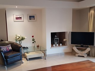 Main floor lounge with flat screen TV, DVD & satelite