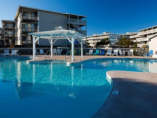 Condo near Beach w/ WiFi, Resort Pools, Tennis, Mini Golf, Grills & Playground