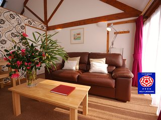 Bowgie 4* barn by a sunny courtyard - in a sheltered valley near the N Coast