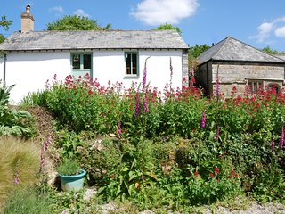 Granary 4* barn by a sunny courtyard - in a sheltered valley near the N Coast