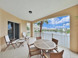 Waterfront condo w/ a furnished balcony, shared pool, hot tubs, gym, & more