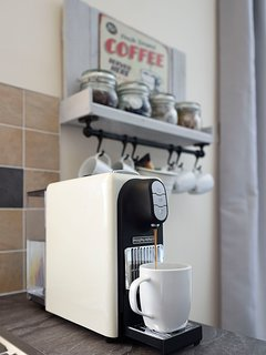 A Nespresso compatible coffee machine is provided for that quick caffeine fix.