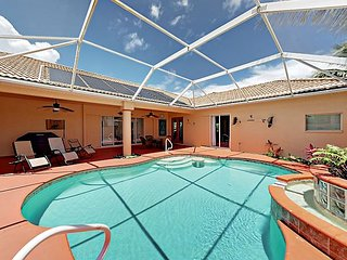 Private Covered Pool & Canal-Front Patio: Waterfront 3BR Near Aquatic Reserve