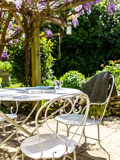Patio outside kitchen - with Wisteria