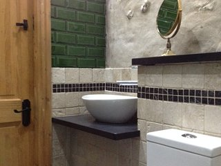 Shower room basin and toilet.