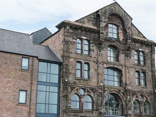 6 MILL WHARF, in Tweedmouth, harbour views, open-plan, converted granary