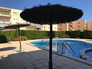 104B - Apartamento con piscina y parking cerca de playa