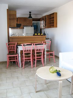 The dining table  and the kitchen