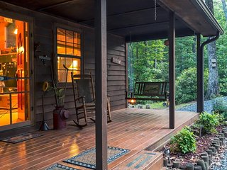 Secluded cabin w/ beautiful forest views, private hot tub, & firepit - dogs OK!