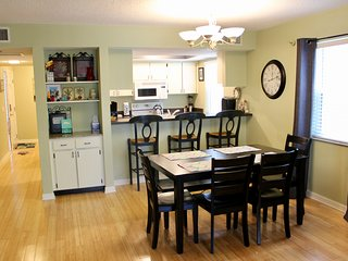 The eat in dining room is perfect for sharing meals with the family.