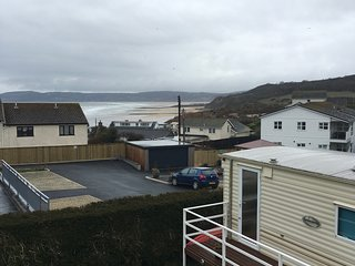 Caravan with beach and sea views in village centre on private land