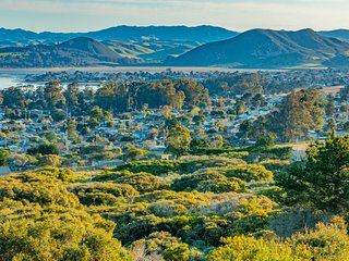 View to the east overlooking Los Osos and the mountain range. Twinkling lights come on at night