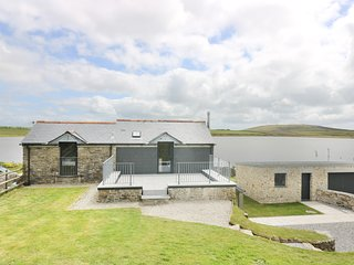 DOZMARY POOL BARN, detached, pet friendly, waterside house with far reaching vie