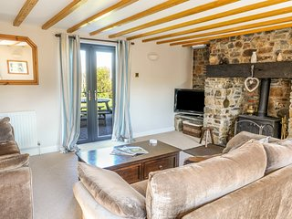 PENBARDEN BARN, spacious barn conversion, woodburner, garden, Crackington Haven,