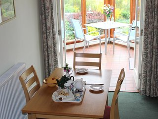 Level access from dining area into your conservatory.