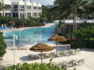 LICENSED MANAGER - MODERN 2/1.5 SUITE - AREA'S MOST UPSCALE OCEANFRONT RESORT!