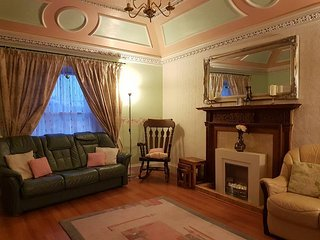 Large lounge seats 10. Ornamental ceiling, free WiFi, games, books and hand carved oak fireplace.