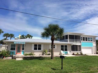Island living at it's best.  Beach just steps away.  On canal with dock.