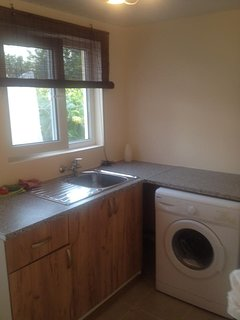 utility room with sink and washing machine